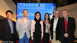 Top players Hikaru Nakamura, Veselin Topalov and Hou Yifan, with Miss Gribraltar, Brian Callaghan (Organiser) and The Hon. Steve Linares, Minister for Sports Culture, Heritage and Youth.